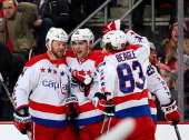 Jason Chimera of the Washington Capitals is congratulated by teammates John ErskineTom Wilson and Jay Beagle after Chimera scored in the third period...