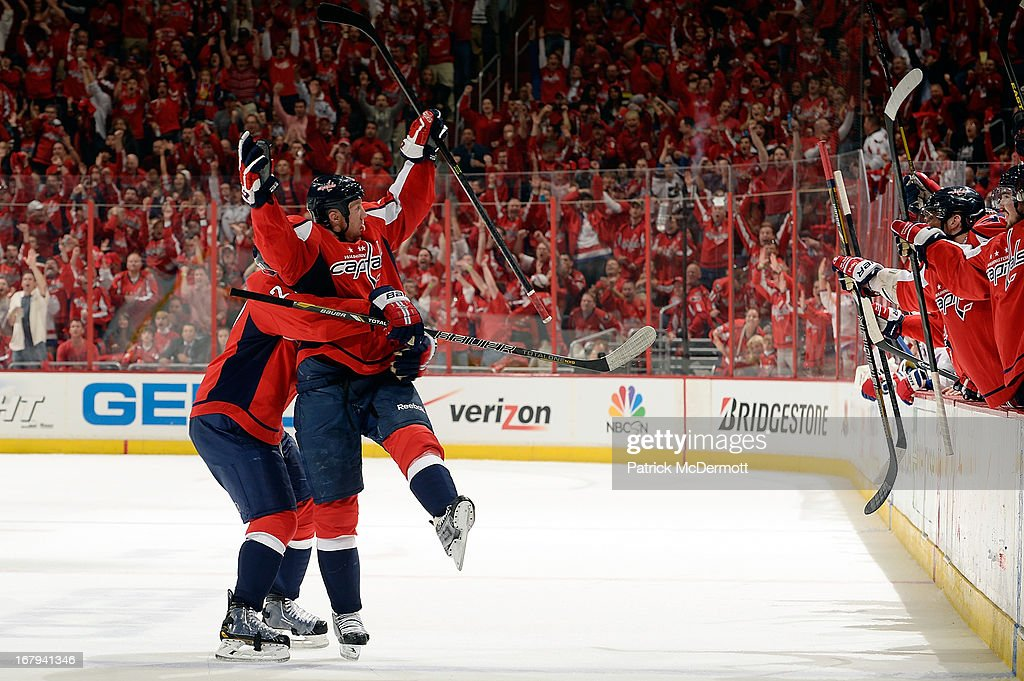 <a gi-track='captionPersonalityLinkClicked' href=/galleries/search?phrase=Jason+Chimera&family=editorial&specificpeople=211264 ng-click='$event.stopPropagation()'>Jason Chimera</a> #25 of the Washington Capitals reacts after scoring a goal against the New York Rangers in the second period of Game One of the Eastern Conference Quarterfinals during the 2013 NHL Stanley Cup Playoffs at Verizon Center on May 2, 2013 in Washington, DC.