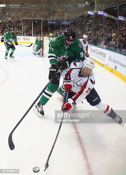 Jason Chimera of the Washington Capitals skates the puck against Tyler Seguin of the Dallas Stars in the second period at American Airlines Center on...