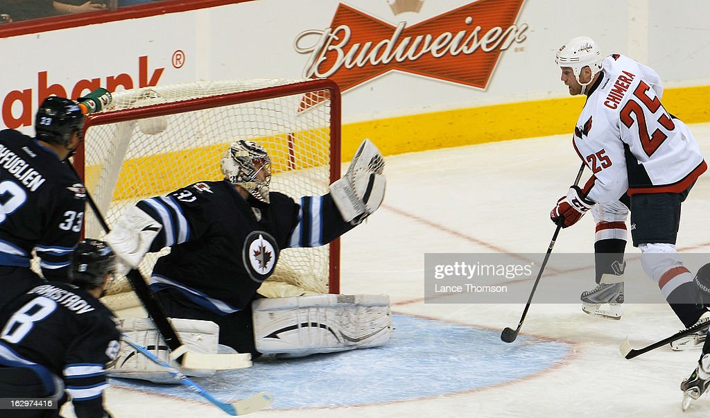 <a gi-track='captionPersonalityLinkClicked' href=/galleries/search?phrase=Jason+Chimera&family=editorial&specificpeople=211264 ng-click='$event.stopPropagation()'>Jason Chimera</a> #25 of the Washington Capitals watches as goaltender Ondrej Pavelec #31 of the Winnipeg Jets robs him of a goal with a big glove save during second period action at the MTS Centre on March 2, 2013 in Winnipeg, Manitoba, Canada.