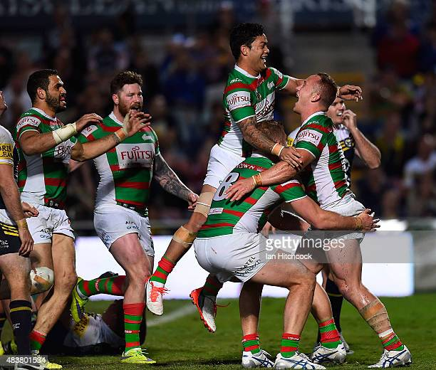 Jason Clark of the Rabbitohs celebrates after scoring a try during the round 23 NRL match between the North Queensland Cowboys and the South Sydney...
