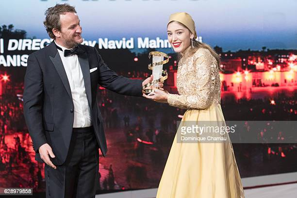 Jason Clarke gives the best actress prize to Fereshteh Hosseini during the closing ceremony of the 16th Marrakech International Film Festival Day...