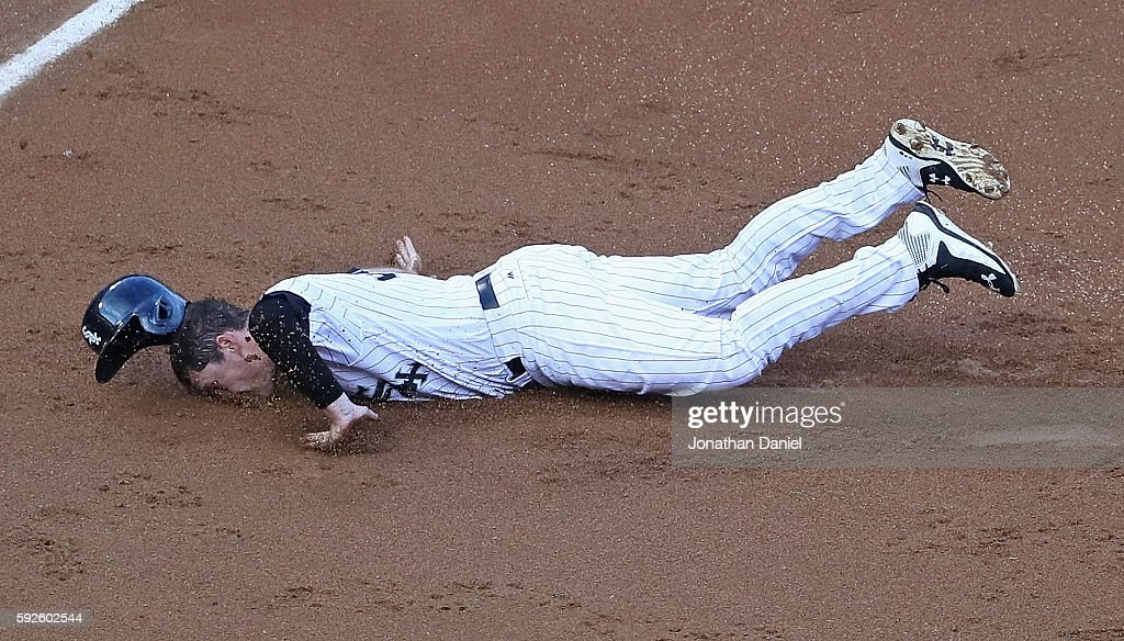 Jason Coats of the Chicago White Sox hits the ground hard as he slides into third base in the 2nd inning against the Oakland Athletics at US Cellular...
