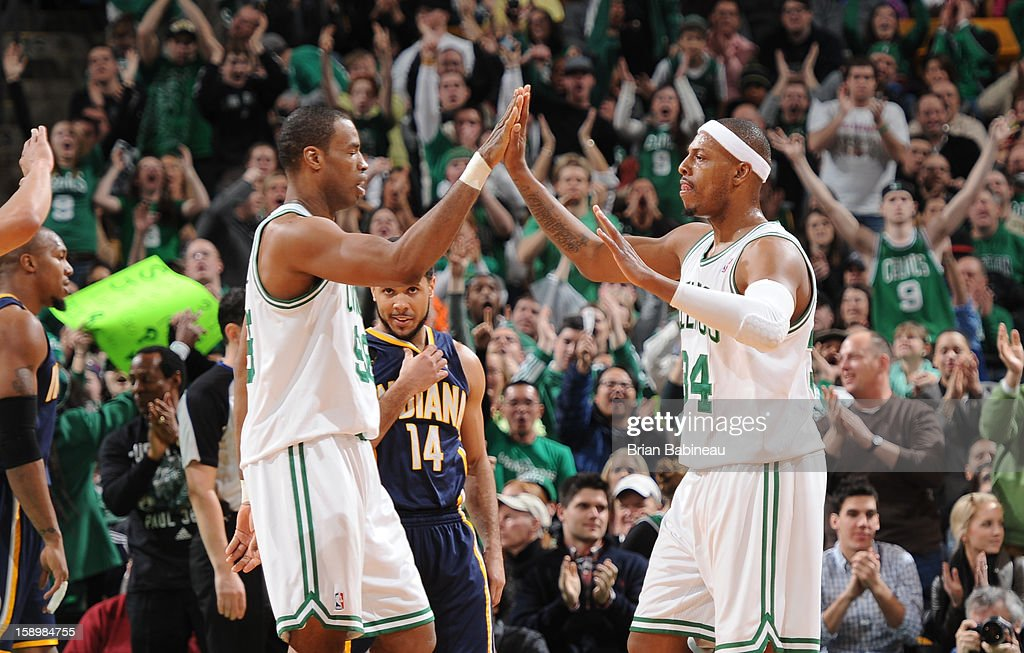 Jason Collins #98 and Paul Pierce #34 of the Boston Celtics congratulate each other during the game against the Indiana Pacers on January 4, 2013 at the TD Garden in Boston, Massachusetts.