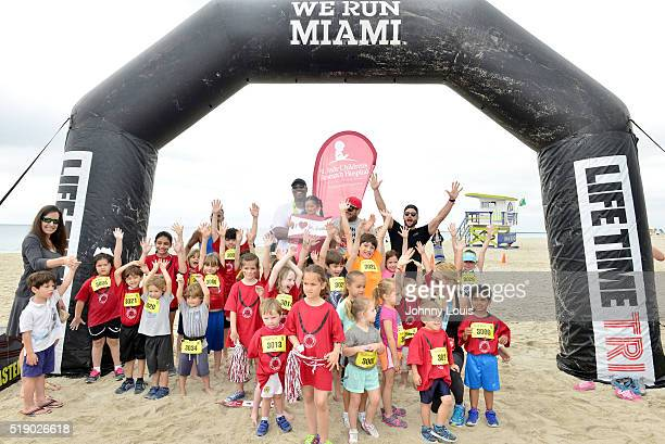 Jason Collins Geoff Stults and Parker Young pose for picture with St Jude Children Takes Part In Life Time South Beach Triathlon swim at Lummus Park...