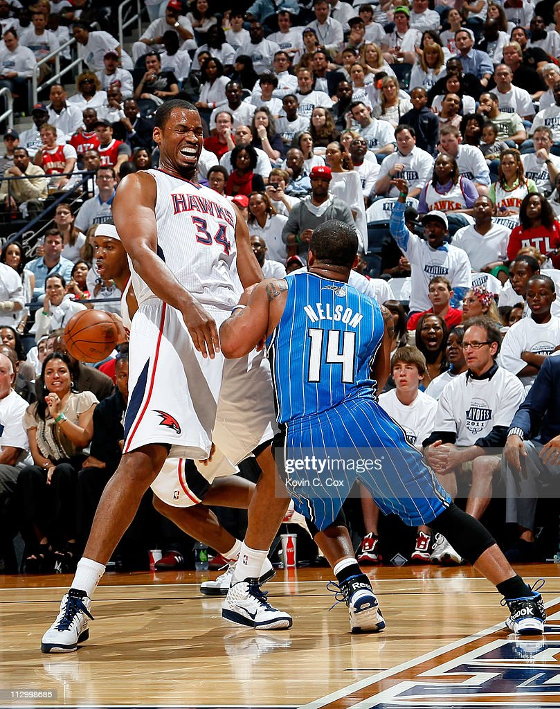<a gi-track='captionPersonalityLinkClicked' href=/galleries/search?phrase=Jason+Collins+-+Basketball+Player&family=editorial&specificpeople=201926 ng-click='$event.stopPropagation()'>Jason Collins</a> #34 of the Atlanta Hawks draws a foul from <a gi-track='captionPersonalityLinkClicked' href=/galleries/search?phrase=Jameer+Nelson&family=editorial&specificpeople=202057 ng-click='$event.stopPropagation()'>Jameer Nelson</a> #14 of the Orlando Magic during Game Three of the Eastern Conference Quarterfinals in the 2011 NBA Playoffs at Philips Arena on April 22, 2011 in Atlanta, Georgia.