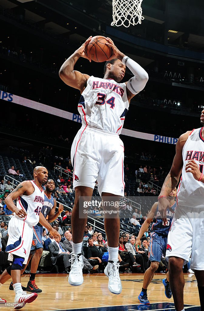 <a gi-track='captionPersonalityLinkClicked' href=/galleries/search?phrase=Jason+Collins+-+Basketball+Player&family=editorial&specificpeople=201926 ng-click='$event.stopPropagation()'>Jason Collins</a> #34 of the Atlanta Hawks grabs a rebound against the Charlotte Bobcats on April 4, 2012 at Philips Arena in Atlanta, Georgia.