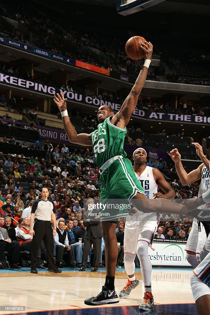 Jason Collins #98 of the Boston Celtics brings down a rebound against Brendan Haywood #33 and the Charlotte Bobcats at the Time Warner Cable Arena on February 11, 2013 in Charlotte, North Carolina.