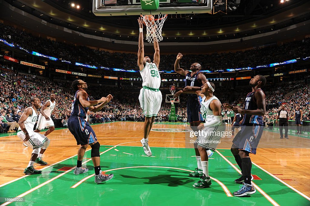Jason Collins #98 of the Boston Celtics rebounds against the Charlotte Bobcats on January 14, 2013 at the TD Garden in Boston, Massachusetts.