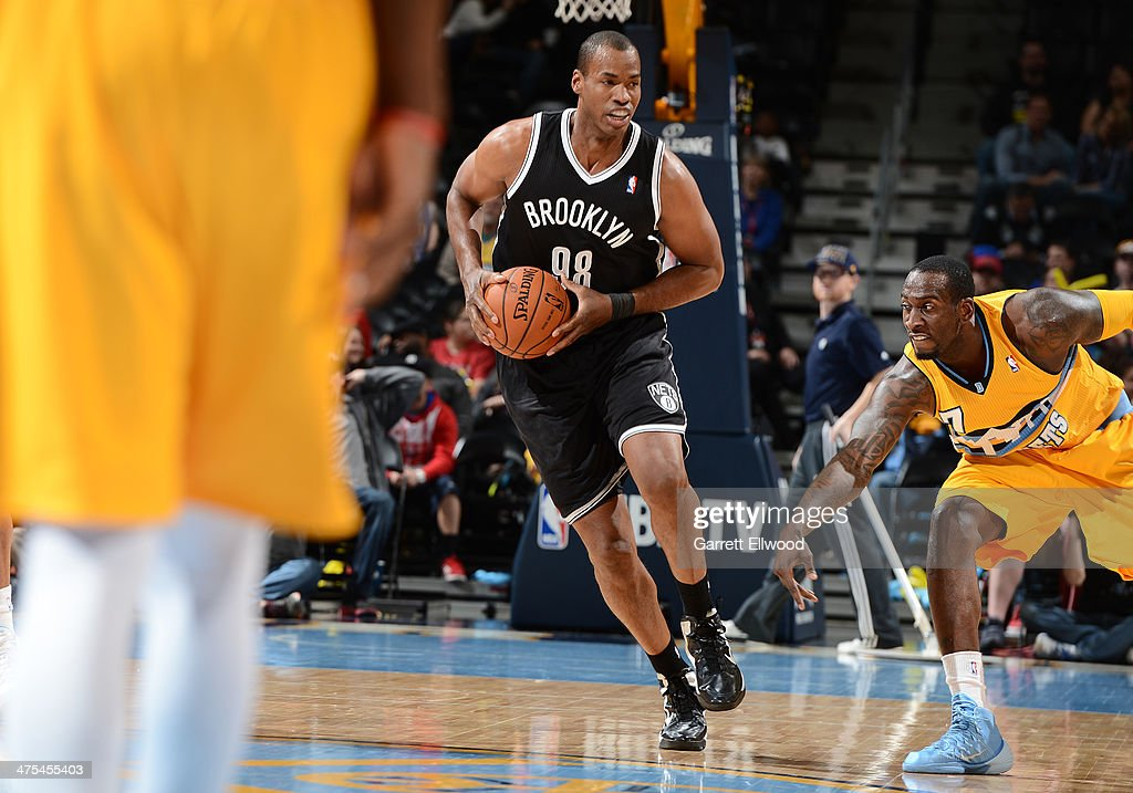 Jason Collins #98 of the Brooklyn Nets handles the ball during a game against the Denver Nuggets on February 27, 2014 at the Pepsi Center in Denver, Colorado.