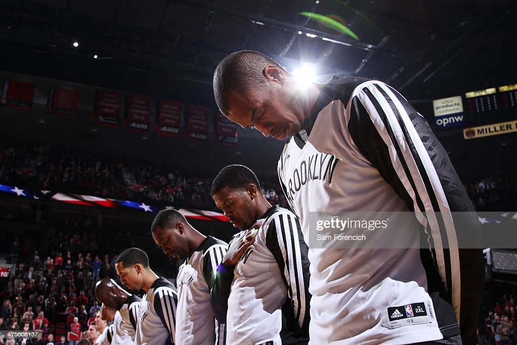 <a gi-track='captionPersonalityLinkClicked' href=/galleries/search?phrase=Jason+Collins+-+Basketball+Player&family=editorial&specificpeople=201926 ng-click='$event.stopPropagation()'>Jason Collins</a> #98 of the Brooklyn Nets stands on the court before the game against the Portland Trail Blazers on February 26, 2014 at the Moda Center Arena in Portland, Oregon.