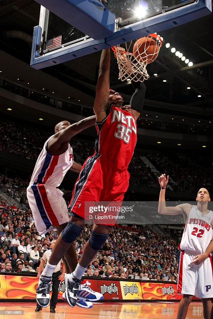 Jason Collins #35 of the New Jersey Nets dunks against the Detroit Pistons on December 26, 2006 at the Palace of Auburn Hills in Auburn Hills, Michigan. The Pistons defeated the Nets 92-91.