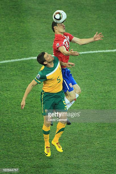 Jason Culina of Australia and Milan Jovanovic of Serbia jump for the ball during the 2010 FIFA World Cup South Africa Group D match between Australia...