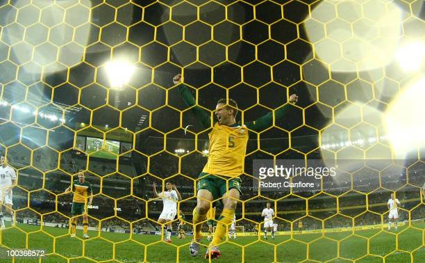 Jason Culina of Australia celebrates the goal of Brett Holman during the 2010 FIFA World Cup PreTournament match between the Australian Socceroos and...