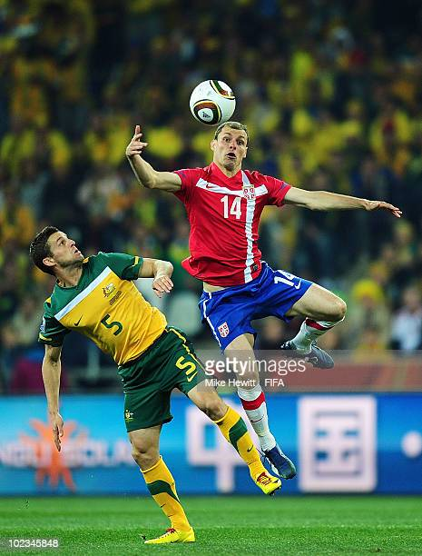 Jason Culina of Australia challenges Milan Jovanovic of Serbia during the 2010 FIFA World Cup South Africa Group D match between Australia and Serbia...
