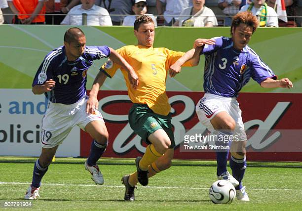 Jason Culina of Australia competes for the ball with Keisuke Tsuboi and Yuichi Komano of Japan during the FIFA World Cup Germany 2006 Group F match...