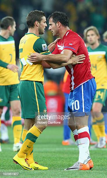 Jason Culina of Australia hugs Dejan Stankovic of Serbia after victory in the game but elimination for both teams from the tournament in the 2010...