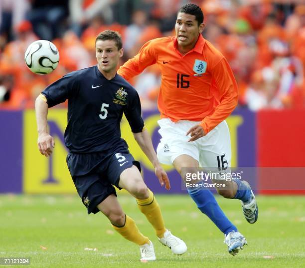 Jason Culina of Australia is challenged by Hedwiges Maduro of the Netherlands during the international friendly match between Netherlands and...