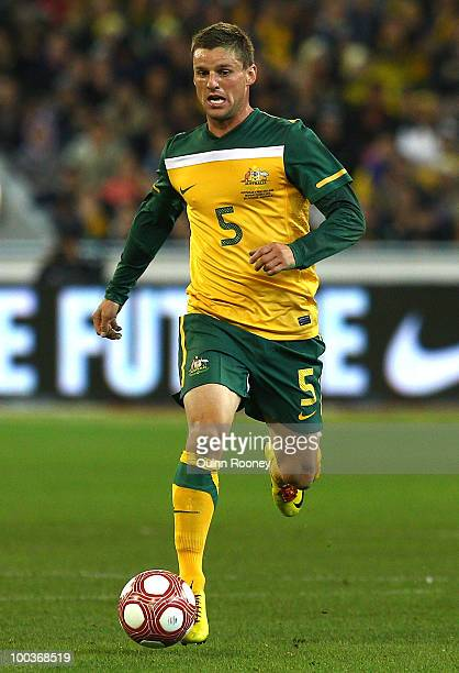 Jason Culina of Australia passes the ball during the 2010 FIFA World Cup PreTournament match between the Australian Socceroos and the New Zealand All...