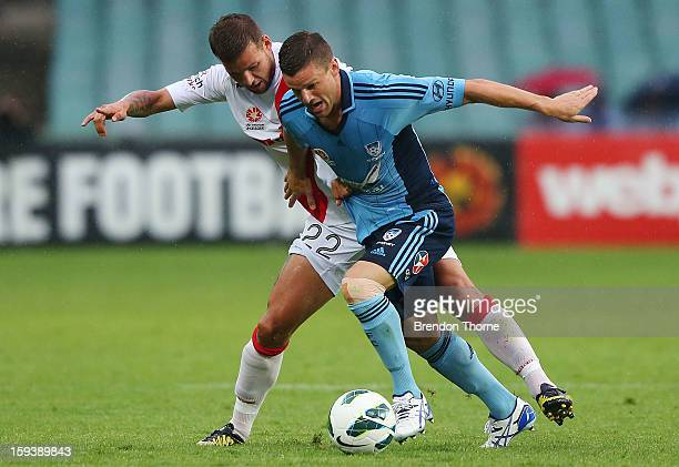 Jason Culina of Sydney competes with Nicholas Kalmar of the Heart during the round 16 ALeague match between Sydney FC and the Melbourne Heart at...