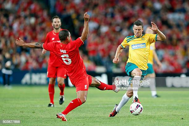 Jason Culina of the Australian Legends evades a challenge by Phil Babb of Liverpool FC Legends during the match between Liverpool FC Legends and the...