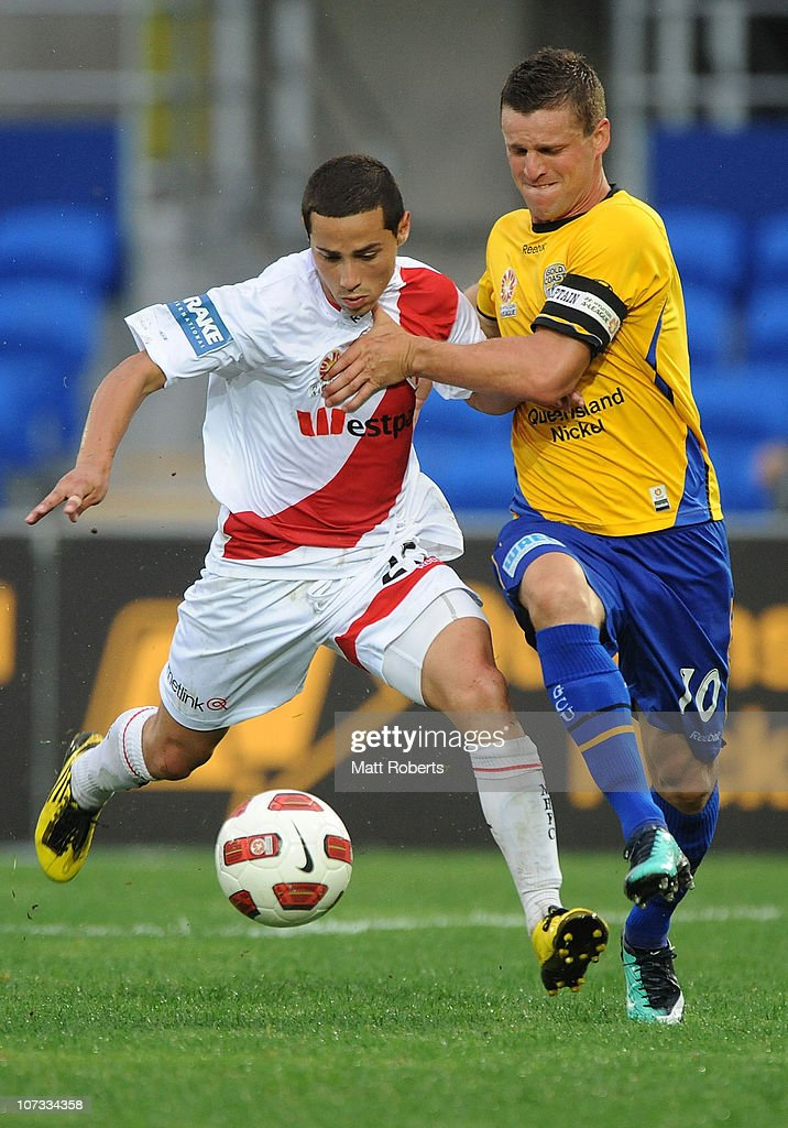 Jason Culina of the Gold Coast contests the ball with Adrian Zahra of the Heart during the round 17 A-League match between Gold Coast United and the Melbourne Heart at Skilled Park on December 5, 2010 in Gold Coast, Australia.