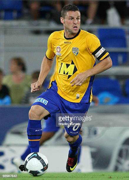 Jason Culina of United looks to take on the defence during the round 17 ALeague match between the Gold Coast United and the Central Coast Mariners at...