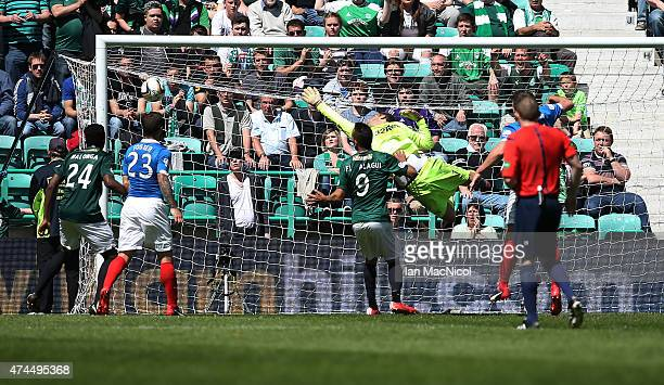 Jason Cummings shot beats Rangers goalkeeper Cammy Bell during the Scottish Championship play off semi final second leg match between Hibernian and...