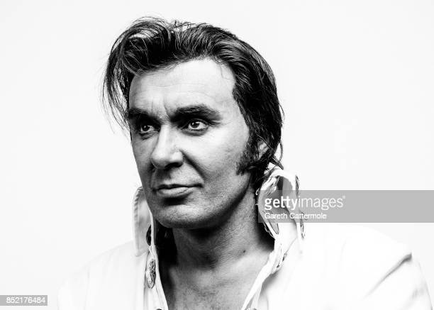 Jason Dale An events Manager from Stoke on Trent poses in a portrait studio during the World's largest gathering of Elvis Presley enthusiasts and...
