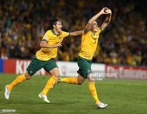 Jason Davidson and Mark Milligan of Australia celebrate a goal during the Asian Cup Semi Final match between the Australian Socceroos and the United...