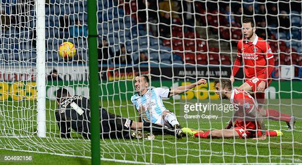 Jason Davidson of Huddersfield Town scores his team's 5th goal during the Sky Bet Championship match between Huddersfield Town and Charlton Athletic...