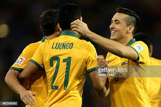 Jason Davidson of the Socceroos celebrates his goal with team mates Massimo Luongo and Mark Milligan during the Asian Cup Semi Final match between...