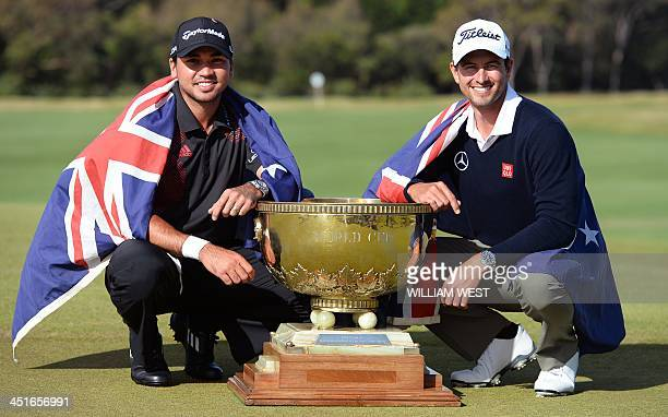 Jason Day and Adam Scott of Australia pose with the trophy after winning the team event of the Golf World Cup tournament played at the Royal...