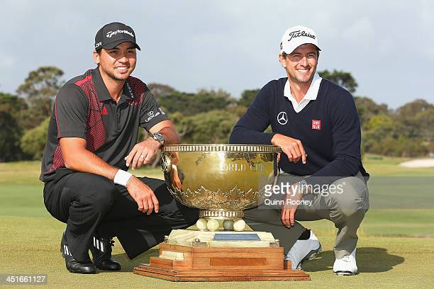 Jason Day and Adam Scott of Australia pose with the trophy after winning the teams event during day four of the World Cup of Golf at Royal Melbourne...