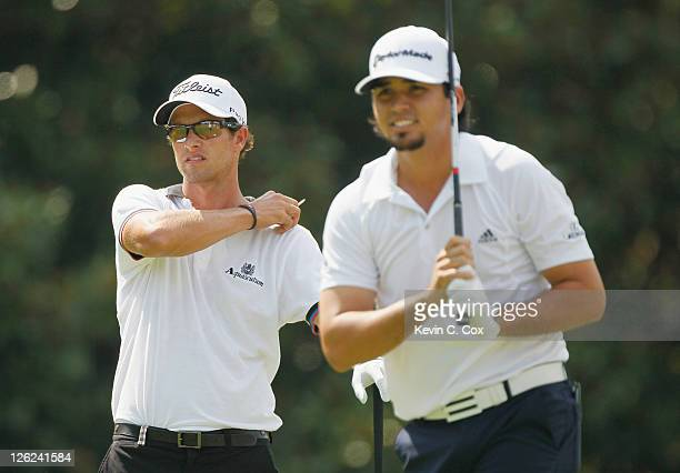 Jason Day and Adam Scott of Australia watch a tee shot on the fifth hole during the second round of the TOUR Championship at East Lake Golf Club on...