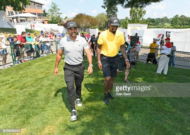 Jason Day and JR Smith make their way to the course during practice of the World Golf ChampionshipsBridgestone Invitational at Firestone Country...