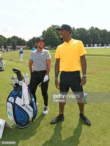 Jason Day and JR Smith of the Cleveland Cavaliers on the range during practice of the World Golf ChampionshipsBridgestone Invitational at Firestone...