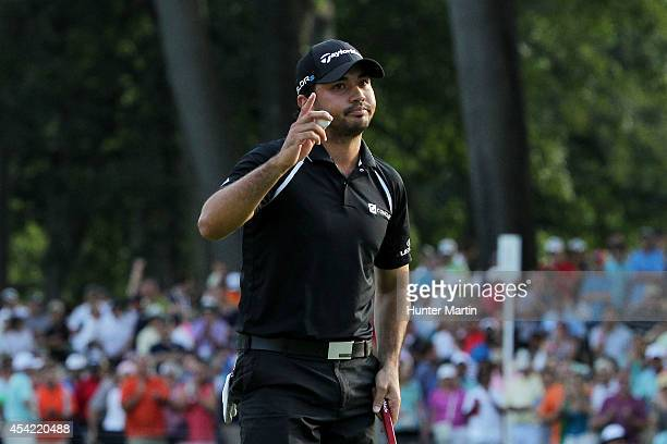 Jason Day of Australia acknowledges the gallery on the 18th green after finishing the final round of The Barclays at The Ridgewood Country Club on...