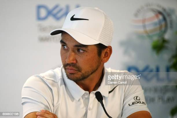 Jason Day of Australia addresses the media during a press conference after withdrawing due to an illness in the family from round one of the World...