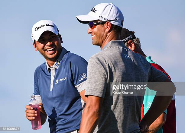 Jason Day of Australia and Adam Scott of Australia laugh as they stand on the 17th hole green during the second round of the US Open at Oakmont...