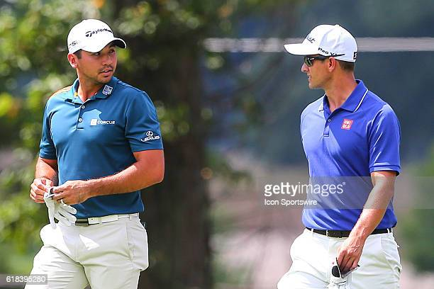 Jason Day of Australia and Adam Scott of Australia talk on their way to the 2nd tee during the second round of The Barclays played at Bethpage State...