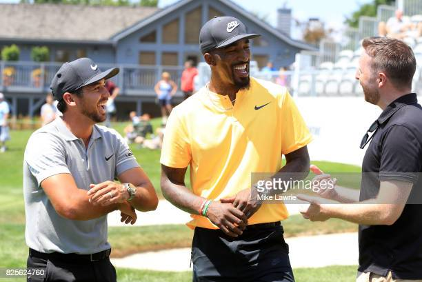 Jason Day of Australia and JR Smith of the Cleveland Cavaliers speak on the 18th green during a preview day of the World Golf Championships...