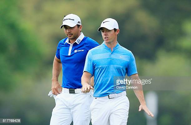 Jason Day of Australia and Rory McIlroy of Northern Ireland walk together up the fifth fairway during their semifinal match at the World Golf...