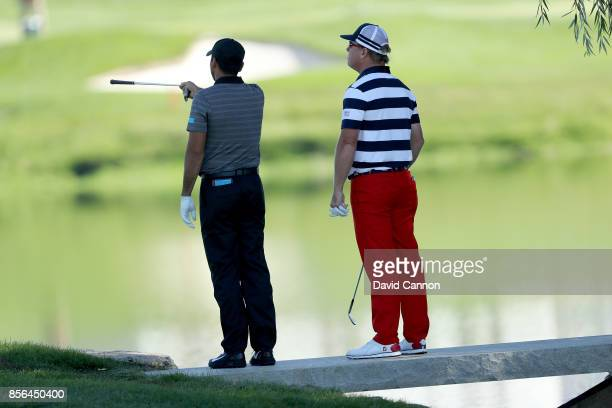 Jason Day of Australia and the International team on the first hole in his match against Charley Hoffman of the United States team deciding where...