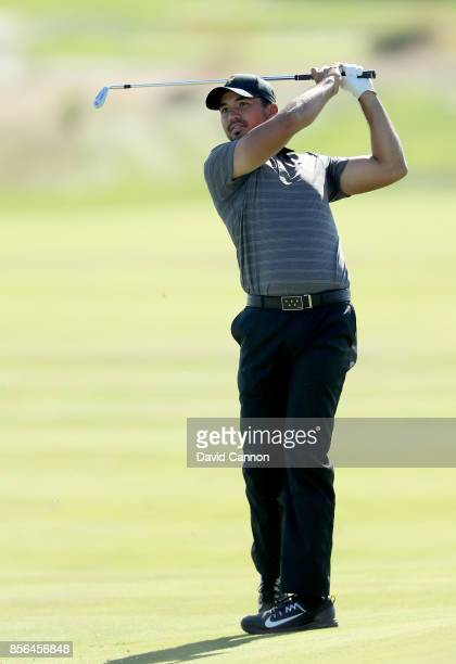 Jason Day of Australia and the International team plays his second shot on the 14th hole in his match against Charley Hoffman of the United States...