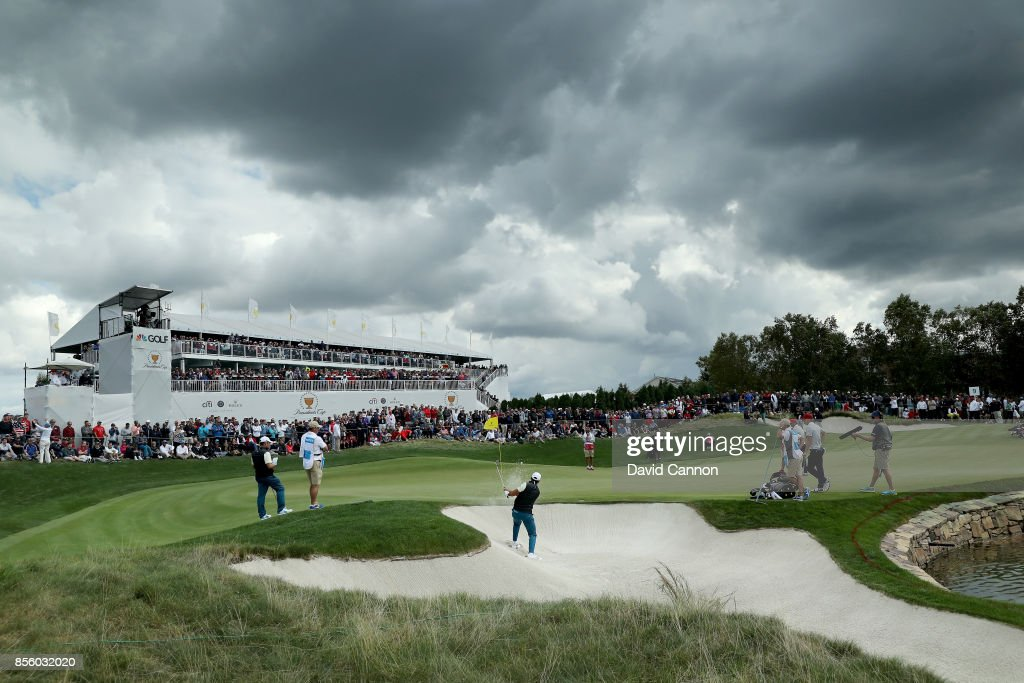 Jason Day of Australia and the International team plays his third shot on the ninth hole in his match with Louis Oosthuizen against Patrick Reed and Jordan Spieth of the United States team during the Saturday afternoon fourball matches in the 2017 Presidents Cup at the Liberty National Golf Club on September 30, 2017 in Jersey City, New Jersey.