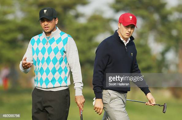 Jason Day of Australia and the International Team waits alongside Jordan Spieth of the United States Team on the second green during the Saturday...