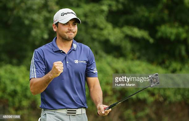Jason Day of Australia celebrates a long birdie putt on the 14th hole during the final round of The Barclays at Plainfield Country Club on August 30...