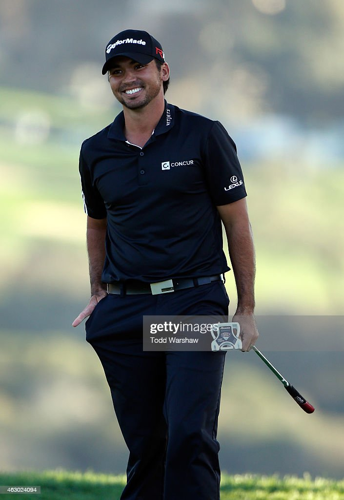 Jason Day of Australia celebrates after his victory on the second playoff hole on the 17th green during the final round of the Farmers Insurance Open at Torrey Pines South on February 8, 2015 in La Jolla, California.