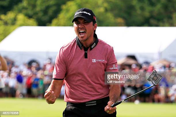 Jason Day of Australia celebrates after putting for birdie on the 18th green to win during the final round of the RBC Canadian Open at Glen Abbey...